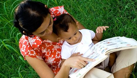 mum reading to baby