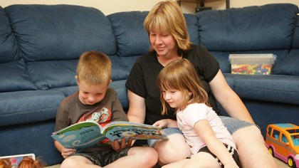 mum reading with children