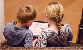 children watching a screen