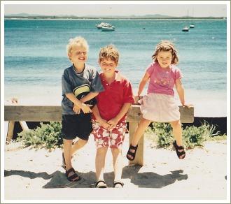 three children at the beach