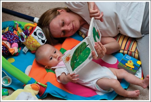 mum reading to baby