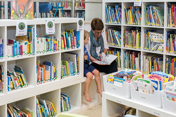mum and son in library,