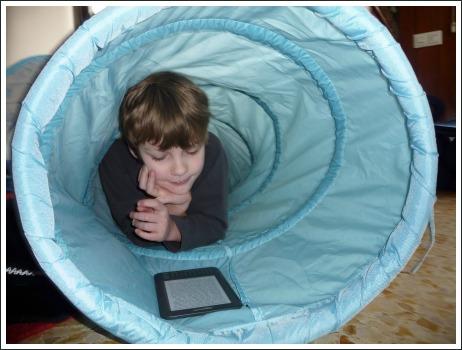 boy reading on amazon kindle