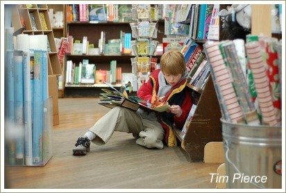 boy reading in book shop