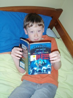 Michelle's youngest son reading his latest favourite book.