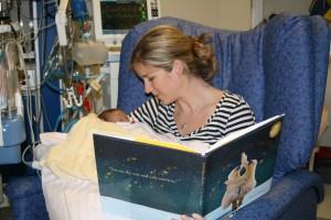 mum reading to premature baby